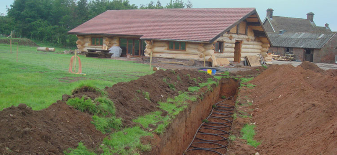CA Heat Pumps example of a Heat Pump Installation showing dug up field with pips laid